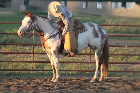 cowboy-in-medford-wi-riding-white-and-brown-paint-horse