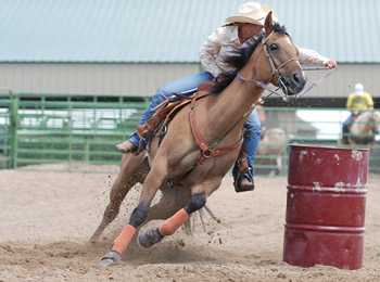 woman-rounding-barrel-with-speed-agility-in-k-bar-r-rodeo-grounds